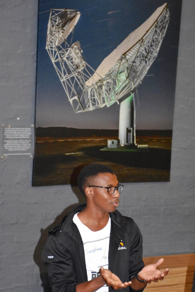 Pictured with an SKA FameLab participant is the South African MeerKAT radio telescope - a precursor to the Square Kilometre Array (SKA) telescope.